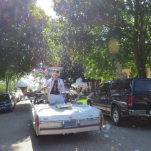 The Bubble Mobile creates a late summer snow storm of bubbles during the Willy Street Fair Parade, September 14, 2014.
