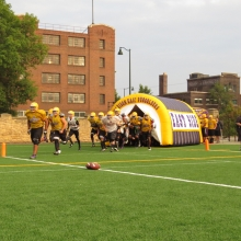 The tunnel even gets a test run as East High School Football returns to Breese Stevens Field, absent since 1975, with a scrimmage on August 8, 2015.