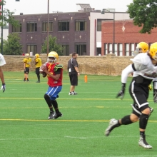 Datrell Thompson prepares to throw a pass during drills as East High School Football returns to Breese Stevens Field, absent since 1975, with a scrimmage on August 8, 2015.