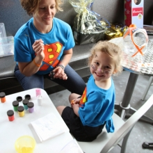 Blake's aunt Stacy Laufenberg Schmidt painted faces for the cause. She was quite busy. Photo  by: Brett Williams