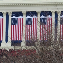 Massive flags cover the Capitol archways at the second Inauguration of President Barack Obama - January 21, 2013.