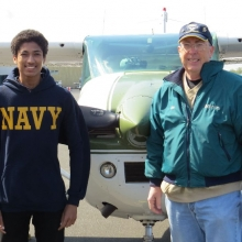 Madison East High Senior Charles Lombardo before his flight with EAA Young Eagle Pilot Bob Gilreath. Lombardo will be entering the Navy in June and took Aviation classes at East High School.