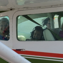 All smiles as two Young Eagles and their mother prepare to fly with pilot Bob Gilreath.