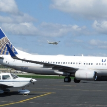 A United Airlines U.S. Military charter prepares to leave the Wisconsin Aviation ramp at the Dane County Regional Airport.