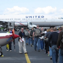 A group of U.S. Servicemen and women head off to a training exercise aboard a charter flown by United Airlines.
