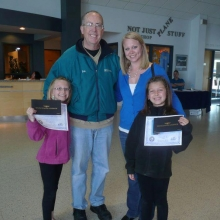 Young Eagle Pilot Bob Gilreath with Gabrielle Masten (left) and Morgan Masten (right) along with their  mother Jennie. Each Young Eagle receives a certificate, logbook, and free online ground school. Courtesy: Jennie Masten