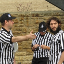 Referees discuss how the game will be called.