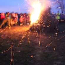 The burned pine needles squirmed like fireflies in the light onshore breeze from Lake Monona during the 2015 Winter Solstice celebration at Olbrich Park on December 22, 2015.