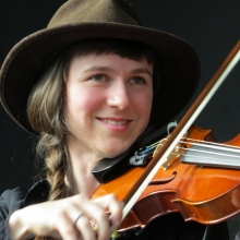 A Mother Falcon violin player.