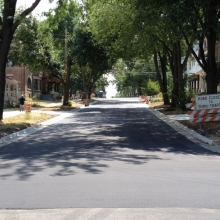 "500 block of S. Ingersoll gets new 'phalt after a long and involved ""down to the dirt"" reconstruction."