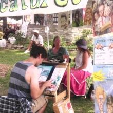 It true local festival fashion, attendees can sit for caricature sessions-airbrushed or black and white the Orton Park Festival, August 25, 2012.