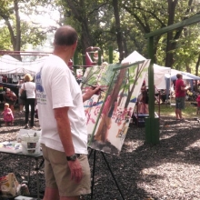 A local artist interprets the scene during the Orton Park Festival, August 25, 2012.