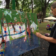 Local artist and art teacher Dan Slick completes a watercolor depicting the playground at Orton Park Festival on Sunday, August 26, 2012.