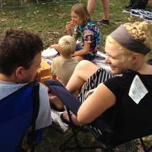 A family picnics and listens to the music during the Orton Park Festival on Sunday, August 26, 2012.