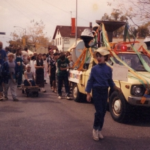 The Willy Street Fair Parade, circa 1985. An earlier incarnation of the Jim Wildeman's Bubblemobile still retains the iconic bubble smokestacks. The author is pedaling furiously in the homemade pedal car. Courtesy: Richard and Judith Guyot.