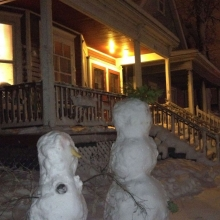 Snow people stand sentry in the 900 block of Willy Street.