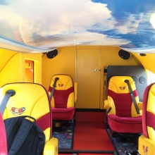 The inside of the Wienermobile is colorful and comfy. We forgot to ask if the cargo area is inside the hot dog part of the vehicle.