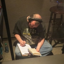 Hashing out the lyrics in the sound booth.