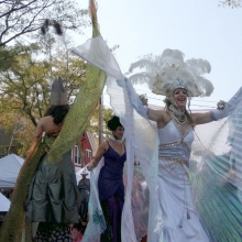 The stiltwalkers prepare to march in the Willy Street Fair Parade.