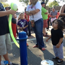 A young child can't wait for her balloon.