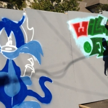 Graffiti artists were invited to paint a temporary permission wall. They say the hardest part is picking the colors.