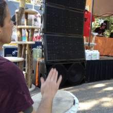 A independent hand drum player beats along to the beats.