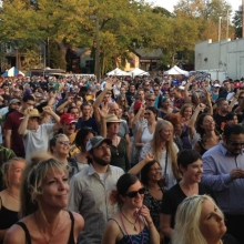 The crowd at the Main Stage dance and shout to Lyrics Born.