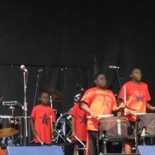 The Black Star Drumline kicked off the Sunday performances on the Main Stage.
