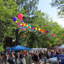 The Willy Street Fair balloon arch painted by the waning summer sun at the Willy Street Fair, September 14, 2014.