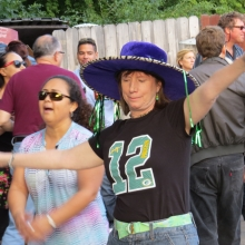 This dancer shows her Packer spirit while dancing to Madisalsa. The game was close this day and the band leader periodically announced the score to the crowd at the Willy Street Fair, September 14, 2014.