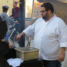 A Pig in a Fur Coat Executive Chef Dan Bonanno serving sandwiches in front of his restaurant at the Willy Street Fair, September 14, 2014.