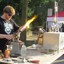 A blown glass artists shows his skills in front of Fat Pinky Glass at the Willy Street Fair, September 14, 2014.