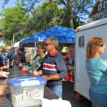 Members of the Hash House Harriers Running Club act as volunteer servers at a beer station at the Willy Street Fair, September 14, 2014.