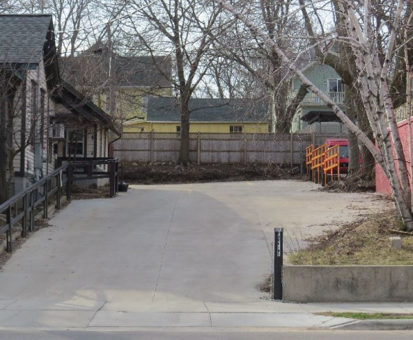 A view of the houses on Jenifer Street from the sidewalk in front of Plan B. The Lee-Skaggs house is the yellow one on the left, the Gallo house is on the right.