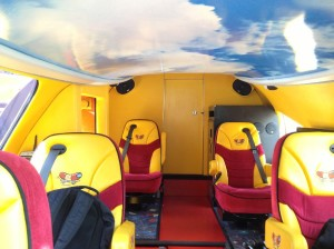 The inside of a Weinermobile, part of the bunroof can be seen above.
