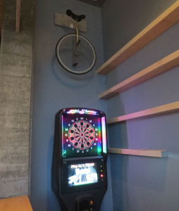 Dart board and unicycle. What bar doesn't have this?