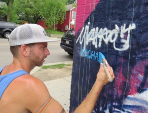 Michael Owen signs his work following just over two days of painting in Madison.