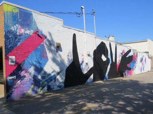 Michael Owen's 22nd Baltimore Love Mural adorns the east side of Plan B Nightclub.