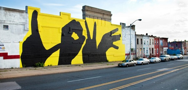 A version of the Baltimore Love Mural which always features the hands in black. Courtesy: Baltimoreloveproject.com