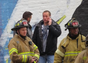Plan B Owner Corey Gresen  (Center) after a fire damaged the nightclub Tuesday December 23, 2014.