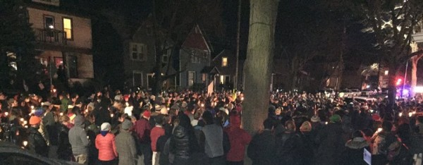 A vigil was held Sunday outside the home where Robinson was shot.