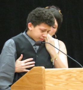 Andrea Irwin comforts her son Jordan Robinson, 15, as he speaks about his brother Tony.