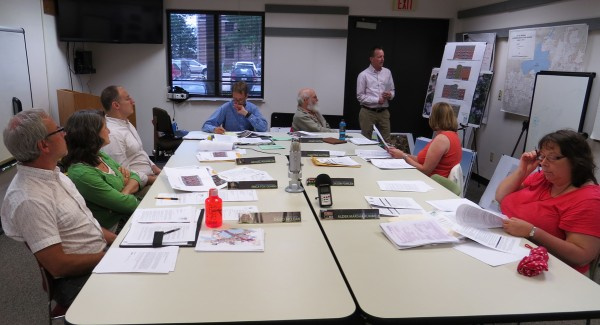 The Landmarks Commission meeting on June 15, 2015. (clockwise) Commissioners David McClean, Erica Fox Gehrig, Micheal Rosenblum, Commission Staff, Chairman Stuart Levitan, Randy Bruce, Knothe-Bruce Architects, Commissioners Christina Slattery and Marsha Rummel.