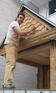 Brandon Cook, at work on his daunting renovation of 1018 Williamson Street. Photo by: Gary Tipler